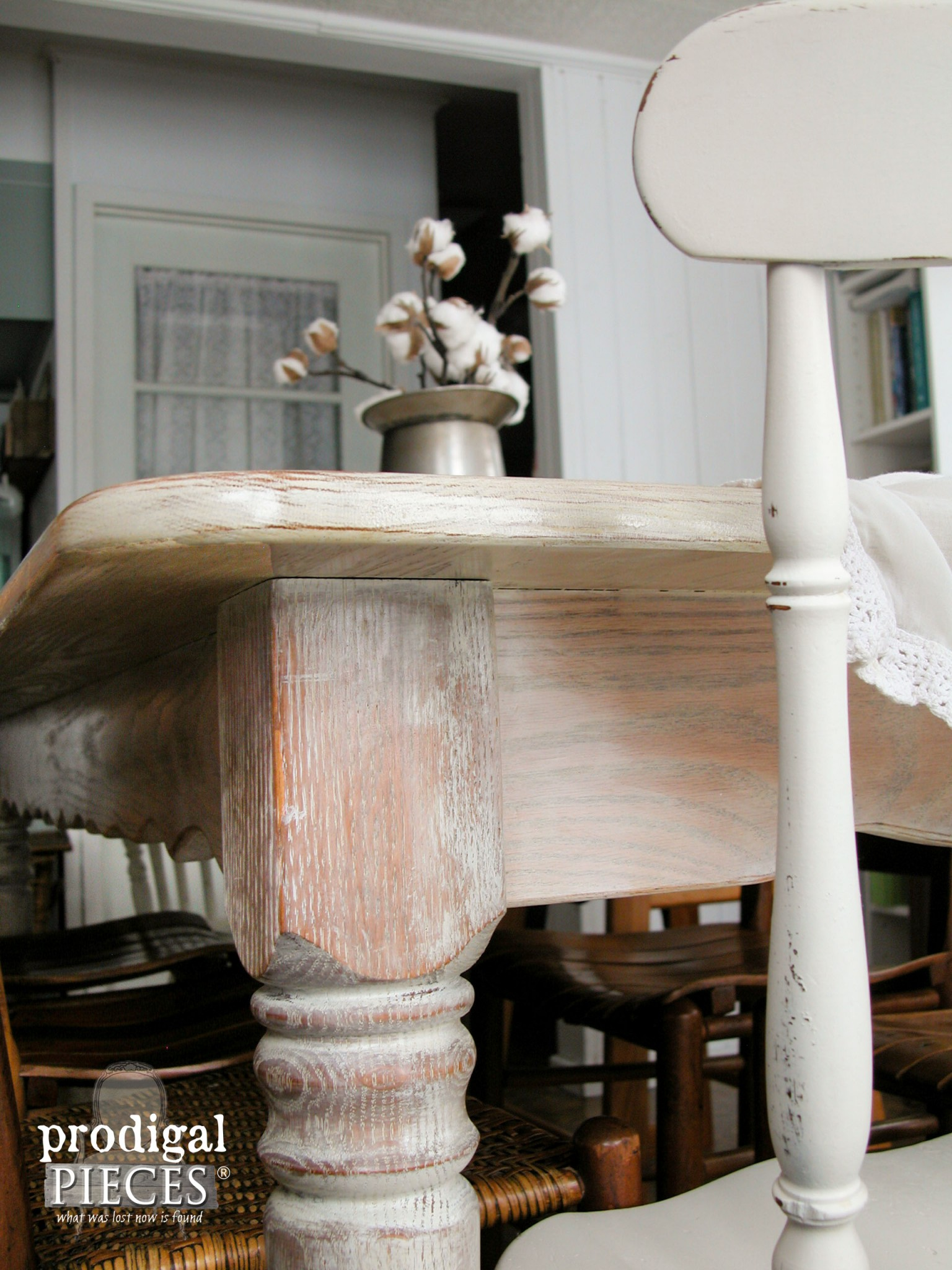 Corner of Whitewashed Farmhouse Table by Prodigal Pieces | www.prodigalpieces.com