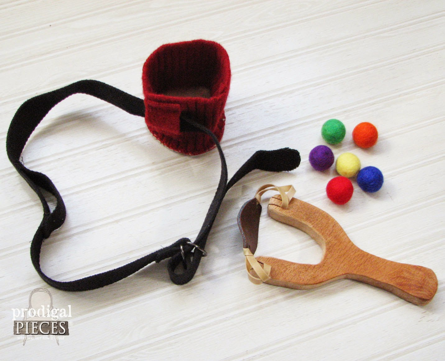Handmade Holidays: Wool Felt Balls with Wooden Toy Slingshot Pretend Play Set by Prodigal Pieces www.prodigalpieces.com #prodigalpieces