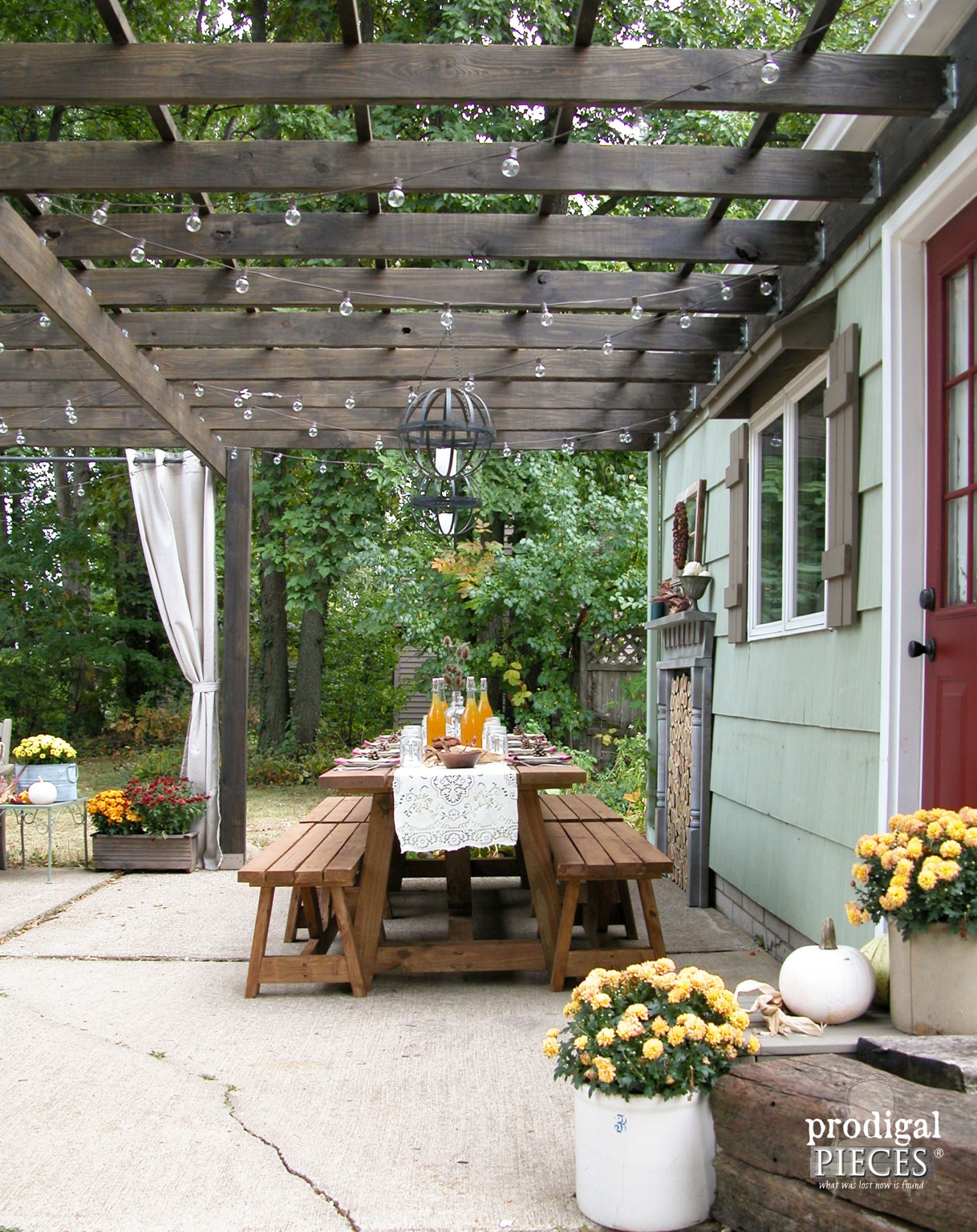 This DIY Patio Design With Pergola Features A Rustic And Repurposed Touches  With A Harvest Table