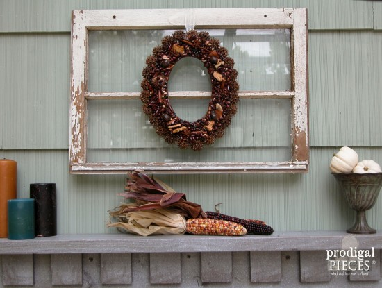 This DIY patio design with pergola features a rustic and repurposed touches with a harvest table, faux fireplace, and curtains for privacy. All completed by one couple on a budget by Prodigal Pieces www.prodigalpieces.com #prodigalpieces